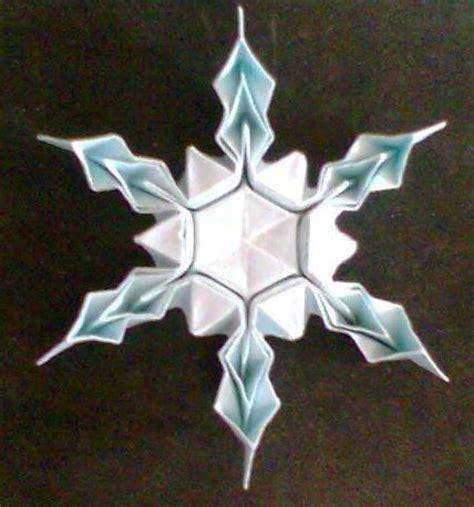 origami snow flakes origami snowflake stringing
