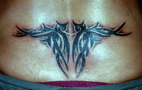 thong tattoo lower back pattern big magic koh phangan thailand