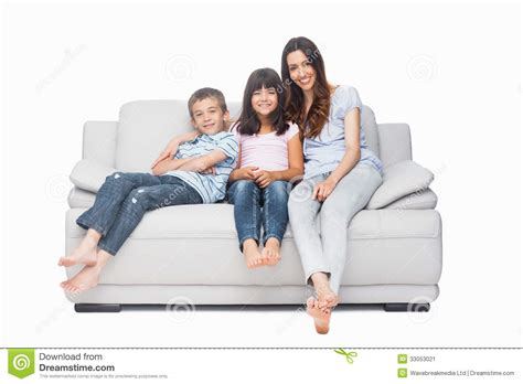 white couch with kids mother with their children sitting on sofa stock image