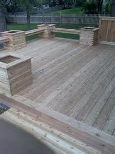 deck with planters and benches and no need for a railing
