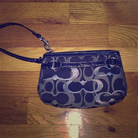 coach navy blue and silver coach navy blue and silver coach wristlet from bri s closet on poshmark