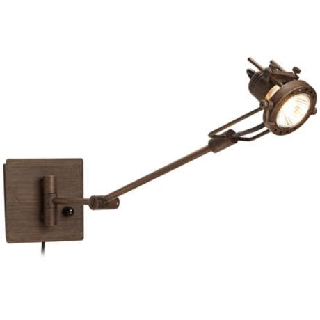 plug in swing spotlight plug in swing arm wall l by possini euro
