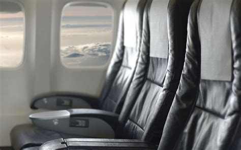 prevent airplane seat reclining airline passenger chokes fellow flyer over reclining seat