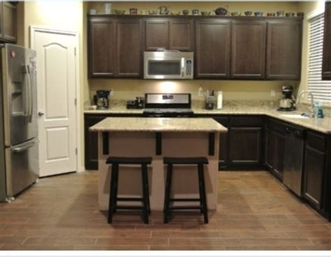 Pictures Of Painted Kitchen Cabinets Before And After Ebony Cabinets And Dark Floor