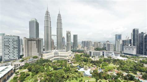 malaysia city kuala lumpur view of the petronas twin towers and klcc park kuala