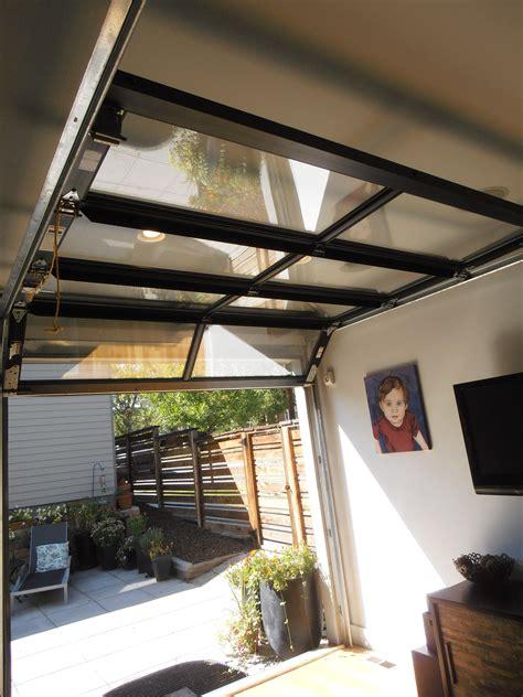 glass garage door  outdoor patio area opens entire wall