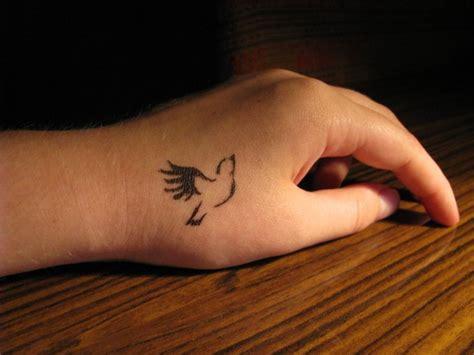 small bird tattoos on foot small dove