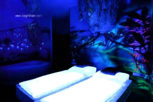 Glow In The Dark Wall Murals artist paints rooms with murals that glow under blacklight