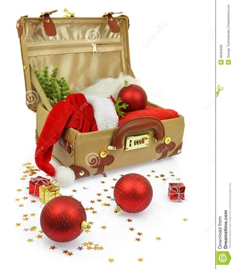 travel suitcase with christmas ornaments stock photo