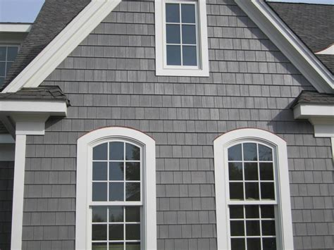 house with gray siding siding windows