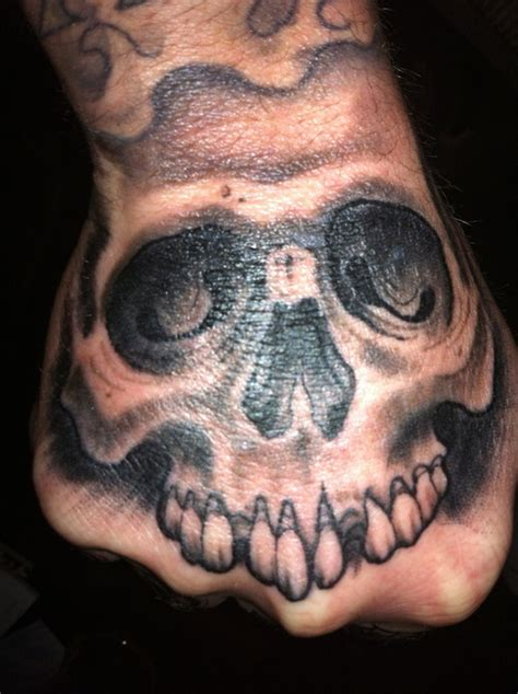tattoo hand skull skull hand tattoo picture at checkoutmyink com