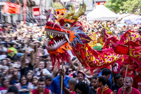 new year festival images sequins and dragons take as the world celebrates