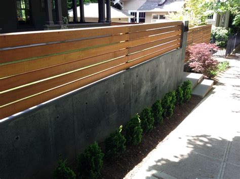 modern retaining wall ideas landscape retaining walls with fences installed ontop