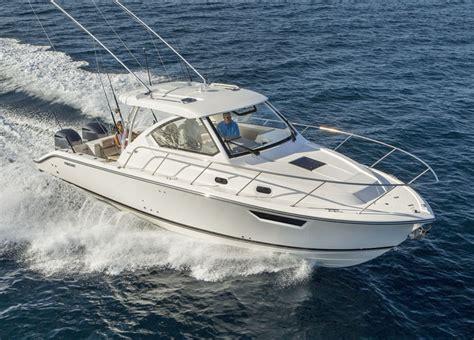 malibu boats buys pursuit os 325 offshore leisure boating