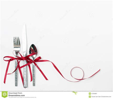 Fancy Place Setting Holiday Silverware With Red Ribbon Stock Photo Image