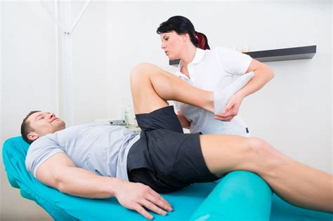 Sports Physical Therapy Section by Watchfit Grab A Partner For This Hamstring Stretch