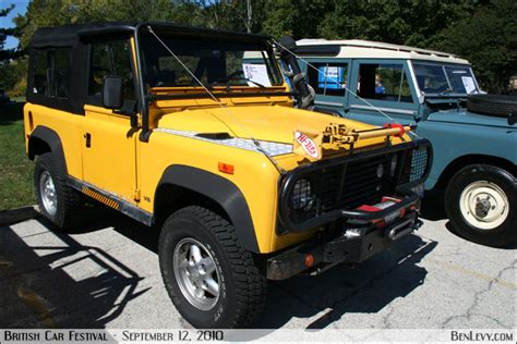 yellow land rover defender benlevy