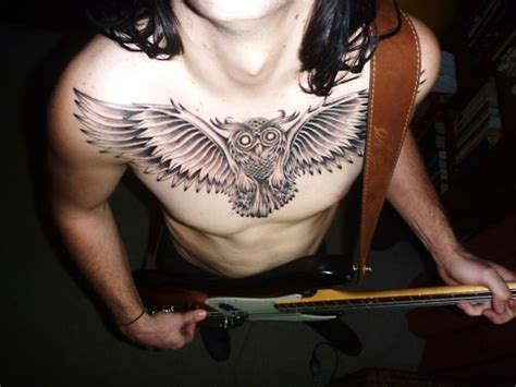 owl chest tattoos for men that s a serious chest to the repetition in