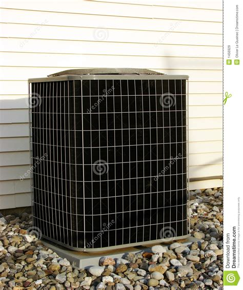 Ac Outdoor air conditioner ac condenser unit outside house royalty