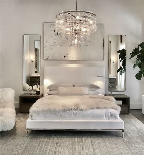 luxury bedroom  white bed white walls chrome assents