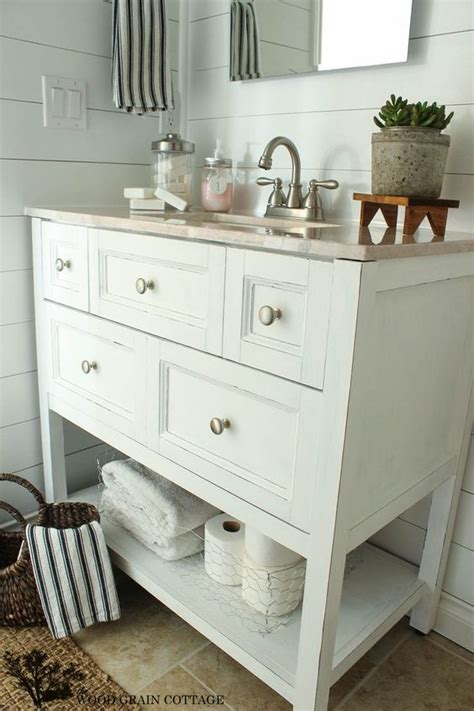 finishing ideas open bathroom vanity with baskets on shelf for storage fav bathroom