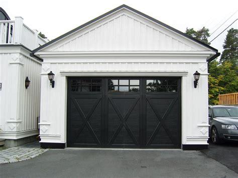 white garage  black  detail doors garage door