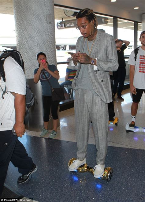 Khalifa Dress Smoke Grey wiz khalifa negotiates lax on his hoverboard and doesn t