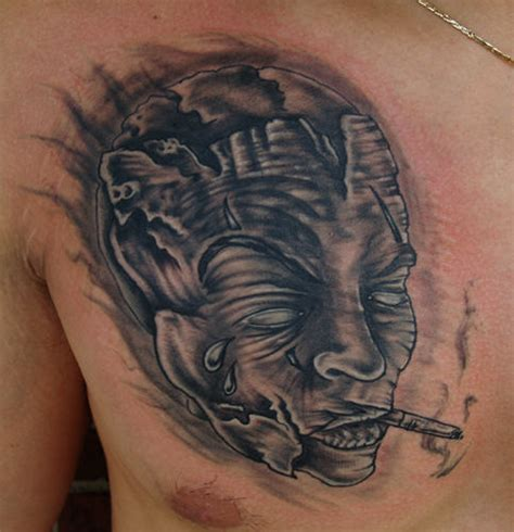 cigar tattoo cigar mask on chest