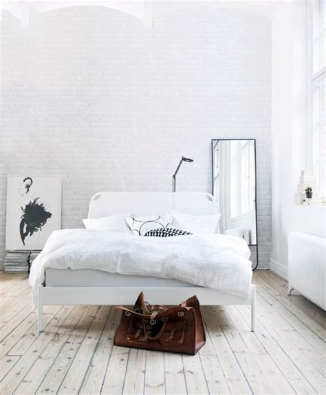 bedroom with white walls painting brick walls white an increasingly popular trend