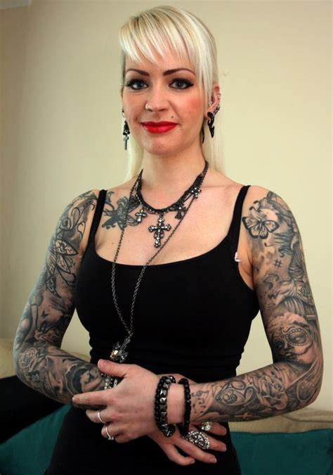 woman covered in tattoos and nhs who is covered in is in