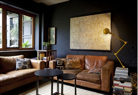 black and tan living room melbourne living room with great contrast of dark walls