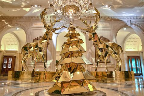 electric light bulb christmas tree and golden reindeer at