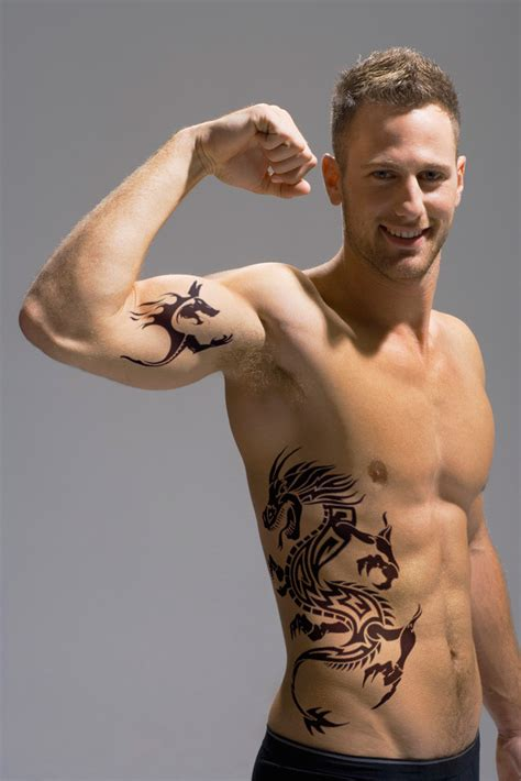places to get a tattoo for men on hip and tribal on bicep designs for