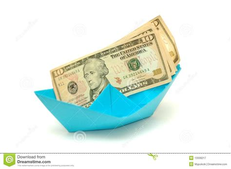 Dollar Origami Boat - dollar on origami boat royalty free stock photography