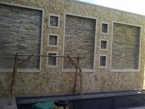 boundary wall design with tiles ingeflinte