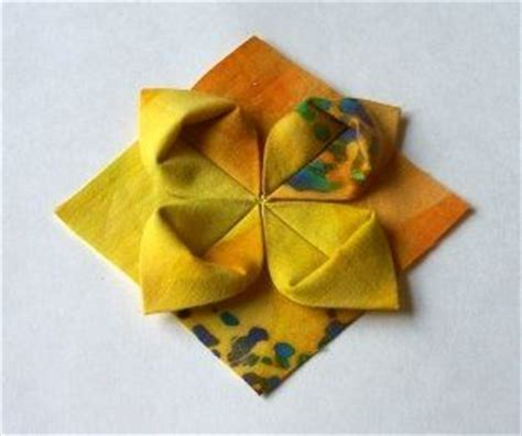 Fabric Origami Flowers - 25 best ideas about folded fabric ornaments on