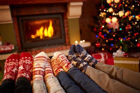 sock fireplace in wool socks near fireplace in winter stock image