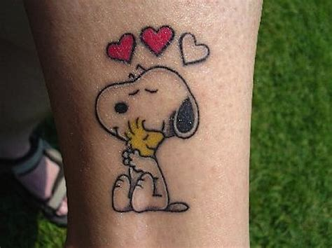 snoopy tattoo designs 21 cool snoopy tattoos ideas