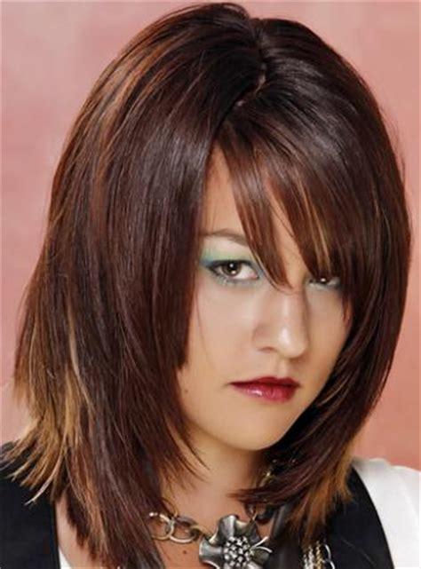 womens medium length layered razor cut hairstyle razor cut hairstyles beautiful hairstyles
