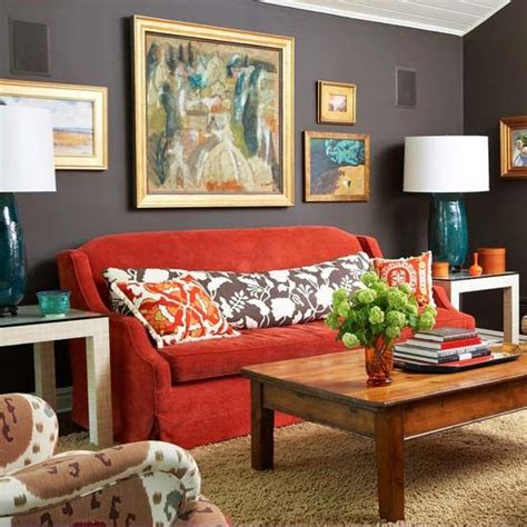 red sofa what color walls bhg dark brown walls red sofa oversized lumbar pillow