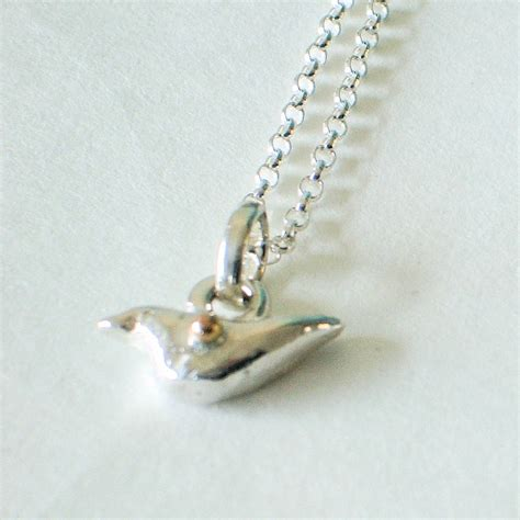 silver bird necklace with gold detail by cathy newell price jewellery notonthehighstreet