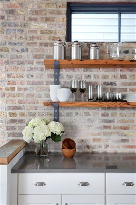 exposed brick kitchen backsplash inspires rustic kitchen chicago by normandy remodeling