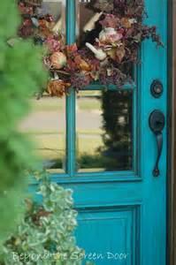 beyond the screen door more turquoise front doors