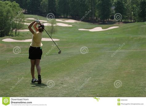 swing time golf baseball lady golf swing stock photos image 2202433