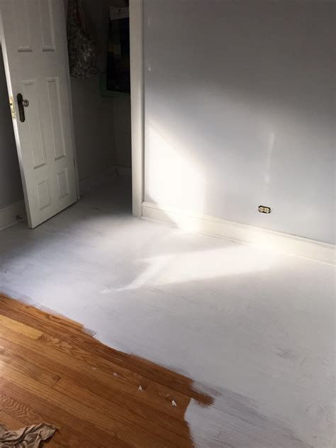 painting a floor painting a wood floor white