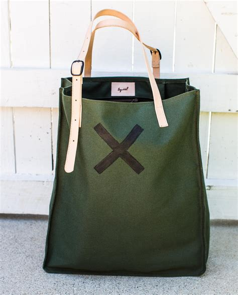 Esquivel Satchel by Giving Back George Esquivel S New Tote Provides Food To