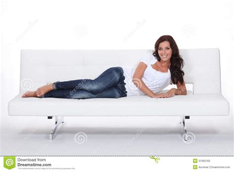 laid on the couch brunette laid on sofa stock photos image 31993183
