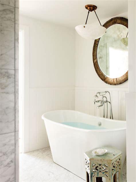 light over bathtub lighting over bathtub transitional bathroom c magazine