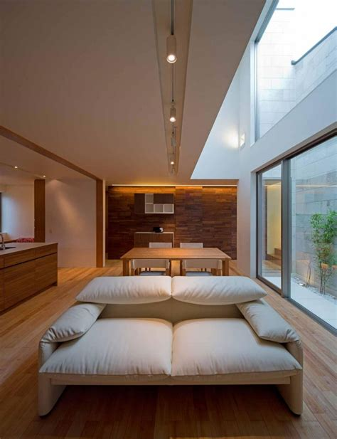 Minimalist Japanese Residence Blends Privacy With An Airy Living Room With High Ceiling