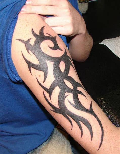 vertical tribal tattoos cool vertical barb and tribal on half sleeve